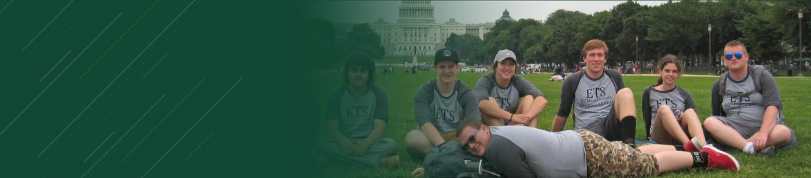 Educational Talent Search students sitting on lawn in front of the US Capital