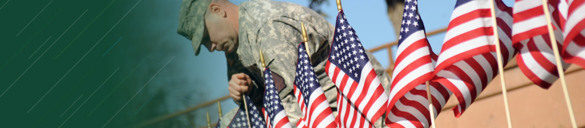 WSCC Veteran placing small flags into ground