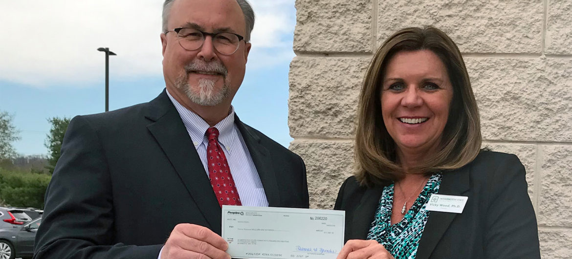 Peoples Bank recently donated $12,000 to the Washington State Community College Foundation in support of scholarships. Shown are (from left to right) WSCC Board of Trustees member Randall Barengo and WSCC President Dr. Vicky Wood accepting the contribution.