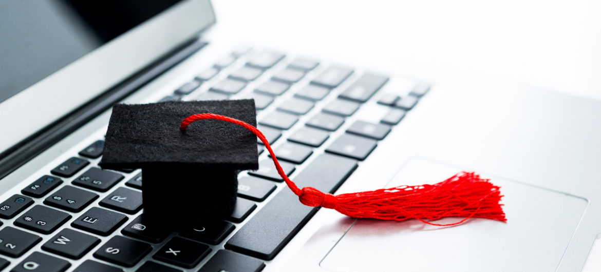 Graduation hat on computer keyboard
